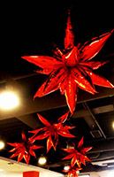 This 30 inch diameter cluster of red mylar leaf-shaped balloons is an eye-catching holiday party ceiling decoration