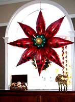 A four foot diameter red mylar balloon poinsettia serves as an elcellent perimeter or wall decoration