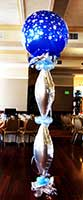 Tbhis 8 foot tall area decoration consists of silver mylar'icecicle' balloons topped by an ice blue 30 inch bubble balloon adorned with snowflake designs