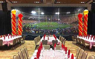 Red and gold balloon column decorations for a 49'ers football theme party