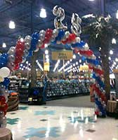 Balloon arch and decorations for a store's 25th anniversary sales event