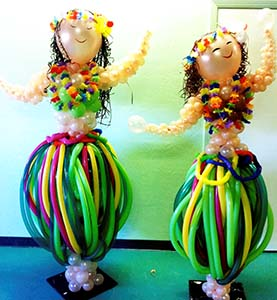 This pair of five foot tall balloon balloon sculpture hula dancers appear to be dancing with their colorful non-round balloon hula skirts