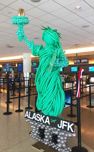 This 8 foot tall balloon sculptures of the  Statue of Libety was created for a San Jose California airport new fligt promotion