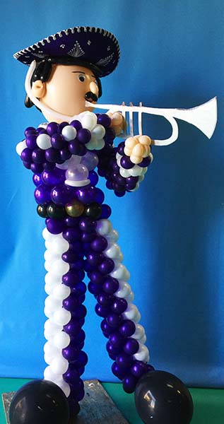 A five foot tall balloon character sculpture of a trumpet playing Mariachi