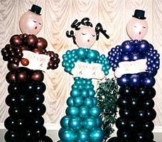 Balloon sculptures of three six-foot tall carolers for a corporate holiday party