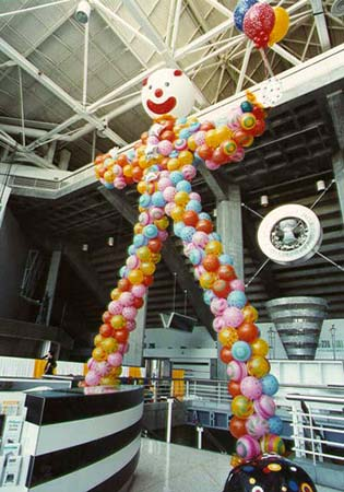 30' tall carnival style walk-thru clown balloon sculpture created for a Silicon Valley company party