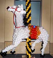 A white balloon sculpture of a carousel horse