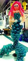Balloon sculpture of a giant mermaid created for a commercial booth at a trade fair