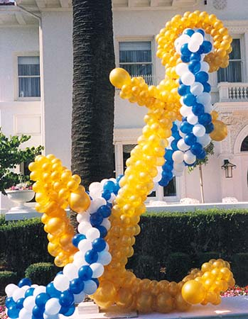 This five foot tall balloon sculpture anchor is constructed from gold balloons and is topped by a line made from blue and white balloons.