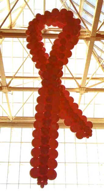 This suspended 15 foot tall balloon sculpture Breast Cancer Ribbon was created for a breast cancer awareness event.