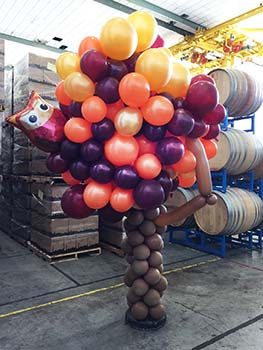This eight foot tall clusted of harvest grapes is being used in a wine tasting room