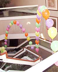 String of pearls arches in pastel colors decorating a stairway at a DoubleTree Hotel