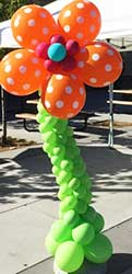 A free standing orange balloon fantaxy flower