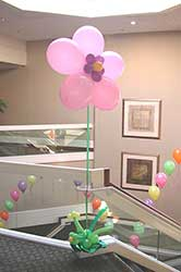 A pearl pink floating fantasy flower placed as a hall decoration.