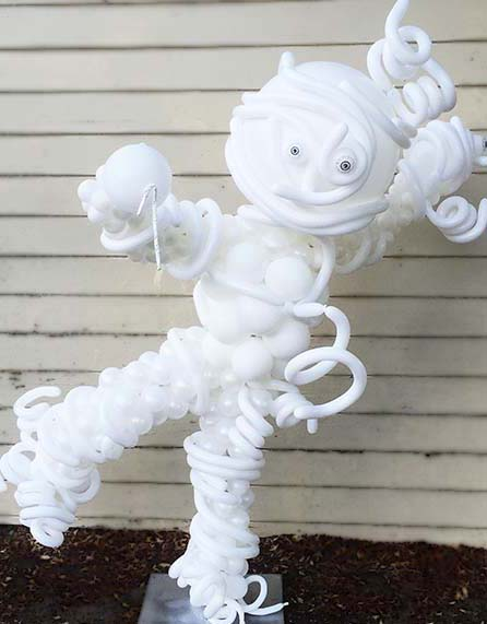 A five foot tall balloon mymmy sculpture dripping its mymmy wrapings all in ghostly white