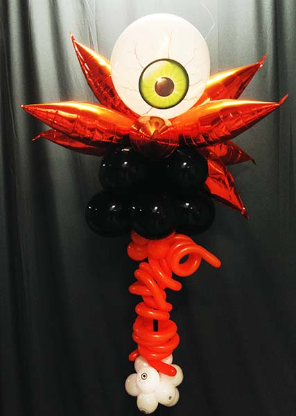 A scary seven foot tall orange and black column topped by a giant staring blood-shot eyeball
