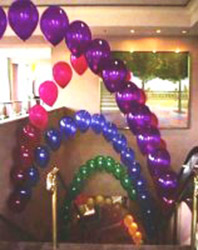 these arches of jewel tone balloons were placed above the escalator to provide a color filled guiide to New Year events.