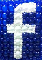 Giant Facebook logo created from balloons for a Facebook corporate party