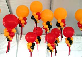 Giant orange and red bubble decorations for corporate event held in a tent</span>