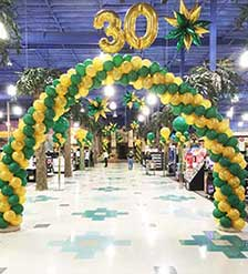 Swirled arch at store entrance for 30th anniversary sale event