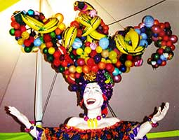 a giant fruit bowl balloon hat for a Carmen Miranda prop at a fund raising event