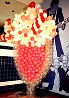 7 foot tall sculpture of a cherry soda used as part of the decor for a fifties party