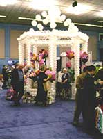 a striking white gazebo constructed from balloons for a trade show booth