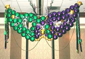 a giant Mardi Gras mask constructed from balloons and foamcor