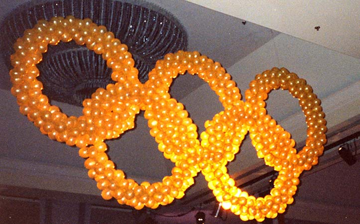 Olympic style rings with lined with lights usedn a focal decoration for the conclusion of a corporate olympic competition