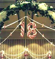 a giant suspended #18 for an 18th birthday celebration at the San Jose Fairmont Hotel