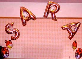 Name sign arch with mylar letter balloons