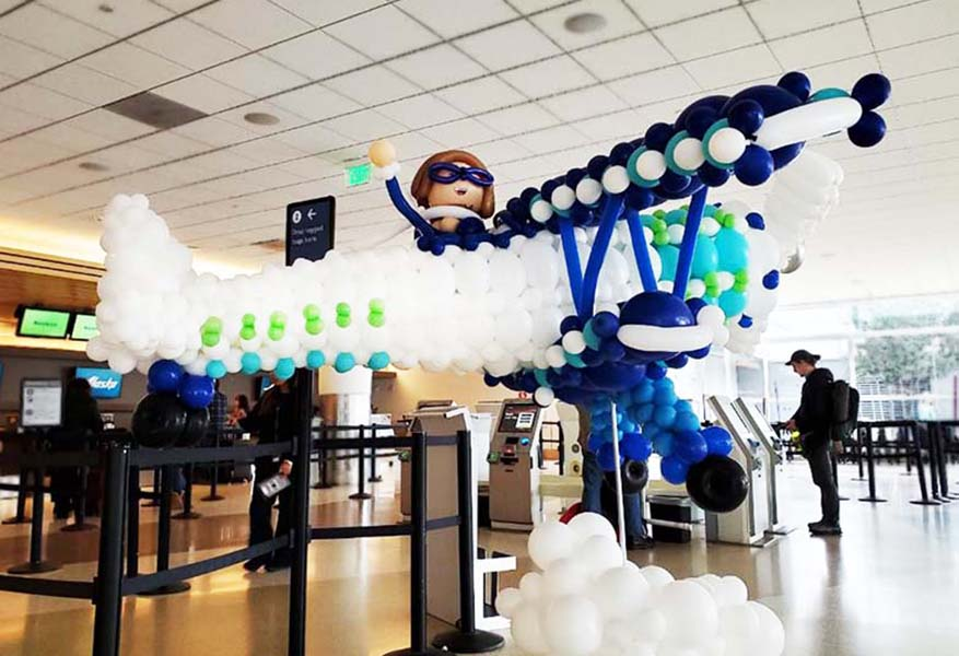 A 10 Long Blue And White Balloon Sculpture Of Biplane Fly By At